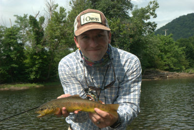 Patrick Fulkrod, owner of South Holston River Company with a nice trout on the Watauga River in Tennessee.