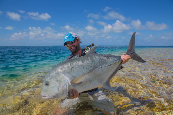 Olive White of Abaco Lodge with a hefty catch from the Seychelles.